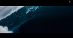 THE SPOT BEGINS WITH HUGE WAVE, FITTING FOR THE EARTHSHAKING GOD OF THE SEA